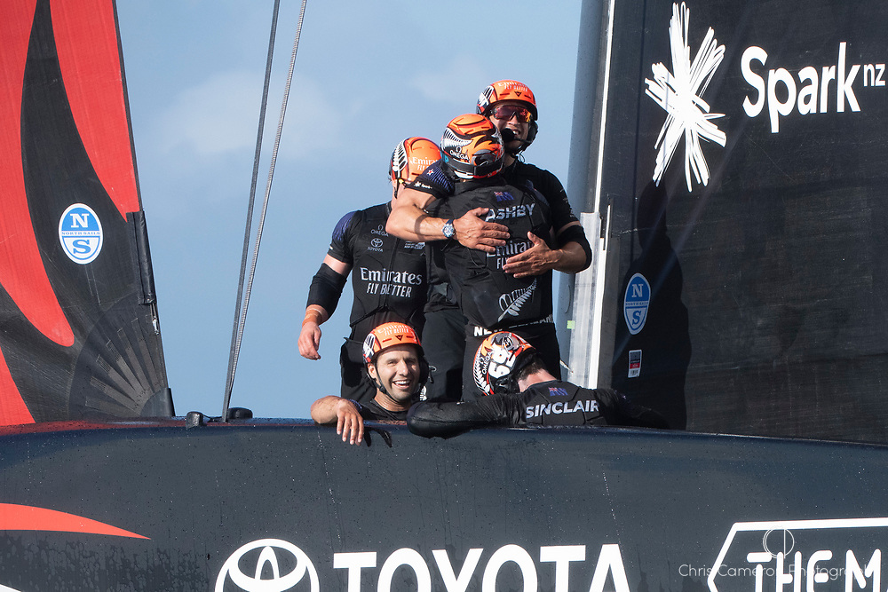 Hugs and smiles aboard Te Rehutai after Emirates Team New Zealand win the America's Cup against Luna Rossa Prada Pirelli Team 7 - 3.  Wednesday the 17th of March 2021. Copyright photo: Chris Cameron
