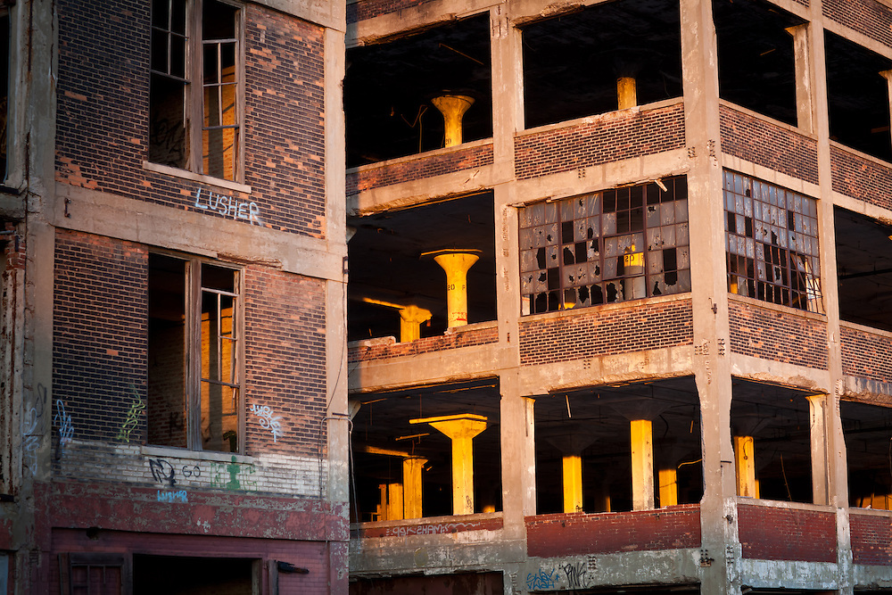 Magic hour light floods the blighted Packard Plant in Detroit.