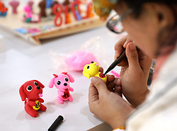 January 30, 2018 - Rongcheng, Rongcheng, China - JIANG XUEJIA, a folk artist in Rongcheng, east China's Shandong Province, makes dog dough figurines marking the arrival of the Chinese lunar New Year. (Credit Image: © SIPA Asia via ZUMA Wire)