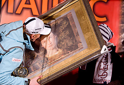 Slovenian athlete Petra Majdic kissing the gift - paintings  when she arrived home with small cristal globus at the end of the nordic season 2008/2009, on March 24, 2009, in Dol pri Ljubljani, Slovenia. (Photo by Vid Ponikvar / Sportida)
