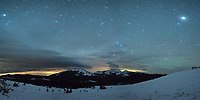 A lenticular cloud hangs above Hesse Mountain at 3AM as seen from Powder River Pass. Lenticular clouds are sculpted by the wind and form repeatedly over the same area, usually a mountain peak. In the upper right of this panorama is Jupiter, with the bright star Vega on the top left.