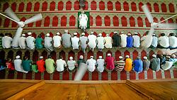 June 24, 2017 - Colombo, Sri Lanka - Sri Lankan Muslim men  offer prayers inside a mosque in Colombo, Sri Lanka on Saturday 24 2017.Muslims across the world are marking the holy month of Ramadan, a period of intense prayer, self-discipline, dawn-to-dusk fasting and nightly feasts  (Credit Image: © Tharaka Basnayaka/NurPhoto via ZUMA Press)