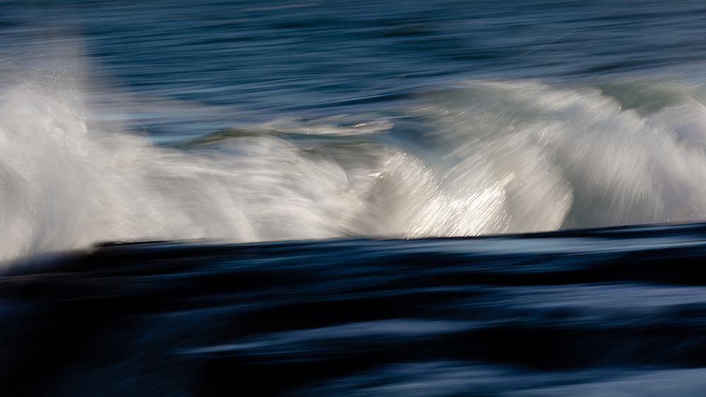 Atlantic Ocean waves clashing with the rocky coastline of Cape Neddick.