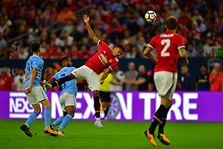 Manchester United midfielder Jesse Lingard (14) heads the ball during the International Champions Cup match between Manchester United and Manchester City at NRG Stadium in Houston, Texas
