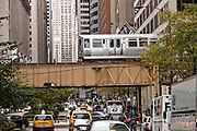 Elevated train known as the L crossing LaSalle Street in Chicago, IL.