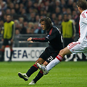 NLD/Amsterdam/20100928 - Champions Leaguewedstrijd Ajax - AC Milan, Jan Vertroghen in duel met Gianluca Zambrotta