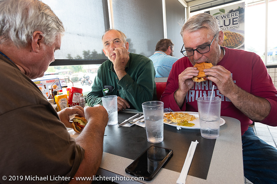 Brothers Mike Butts (L) and Steve Butts <br /> (R) enjoy a Waffle House lunch with Jerry Wieland during the Cross Country Chase motorcycle endurance run from Sault Sainte Marie, MI to Key West, FL. (for vintage bikes from 1930-1948). Stage-7 covered 249 miles from Macon, GA to Tallahassee, FL USA. Thursday, September 12, 2019. Photography ©2019 Michael Lichter.