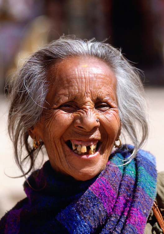 Local grey-haired woman laughing in Nepal