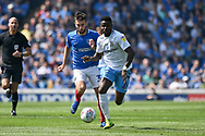 Coventry City Forward, Bright Enobakhare (24) gets away from Portsmouth Midfielder, Ben Close (33) during the EFL Sky Bet League 1 match between Portsmouth and Coventry City at Fratton Park, Portsmouth, England on 22 April 2019.