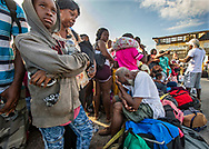 Evacuees wait for transportation to leave Marsh Harbour Port  on Abaco Island on Saturday, September 7, 2019.