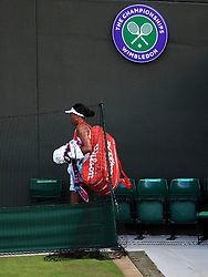 Venus Williams leaves court one dejected following her loss to Cori Gauff on day one of the Wimbledon Championships at the All England Lawn Tennis and Croquet Club, Wimbledon.