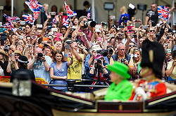 © Licensed to London News Pictures. 11/06/2016. London, UK. Members of the public watch a carriage carrying Queen Elizabeth II during Trooping The Colour ceremony in London,  part of a weekend of celebration to mark the 90th birthday of Queen Elizabeth II,  Britain's longest reigning monarch. Photo credit: Ben Cawthra/LNP