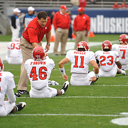 Oct 31, 2009; East Hartford, CT, USA; Rutgers head coach Greg Schiano shakes hands with Pat Brown (46) before first half Big East NCAA football action between Rutgers and Connecticut at Rentschler Field.