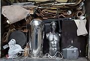 A silver male mannequin sits in the back of a lorry with other shop fittings to be junked, in the heart of the Square Mile, the capitals historical and financial centre, on 1st November 2017, in the City of London, England.