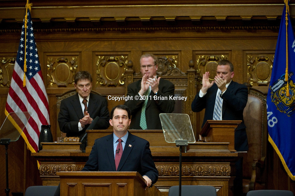 Wisconsin Gov. Scott Walker delivers his budget address to a joint session of the legislature at the state Capitol on March 1, 2011 in Madison, Wisconsin. Walker's budget proposal includes $1.5 billion in cuts in aid to public schools and local government but does not raise taxes or fees, or include furloughs or widespread layoffs.        (Photo by Brian Kersey)