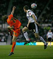 Photo: Steve Bond.<br /> Derby County v Luton Town. Coca Cola Championship. 20/04/2007. Steve Howard (R) and Markus Heikkinen (R) in an aeriel challange