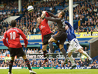 Fotball<br /> England 2005/2006<br /> Foto: SBI/Digitalsport<br /> NORWAY ONLY<br /> <br /> FA Barclays Premiership<br /> Everton v Manchester United<br /> 13th August, 2005<br /> Manchester United's Wayne Rooney (L) uses his hand to try to get to the ball before Everton goalkeeper Nigel Martyn