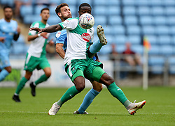 Coventry City's Tony Andreu (left) and Plymouth Argyle's Yann Songo'o battle for the ball