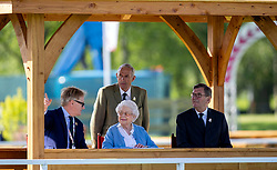 Queen Elizabeth II watches one of her horses compete during day one of the Royal Windsor Horse Show at Windsor Castle, Berkshire.