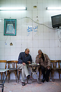 Men sit at a cafe in Islamic Cairo, Cairo, Egypt