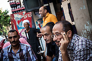 Cairo residents discuss country's political situation in a cafe in surburban Cairo