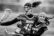 Monroe Township's Teuta Cosaj (left) and Sam Clark (right) celebrate after winning the game against Old Bridge held at Lombardi Field in Old Bridge on April 16, 2011. Monroe went on to beat Old Bridge by a score of 7-6.