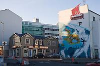 Hafnarstræti in Reykjavík City Center. Rammagerðin Souvenir shop has a illustration on its wall. Rammagerðin og veitingarstaðir í Hafnarstræti.