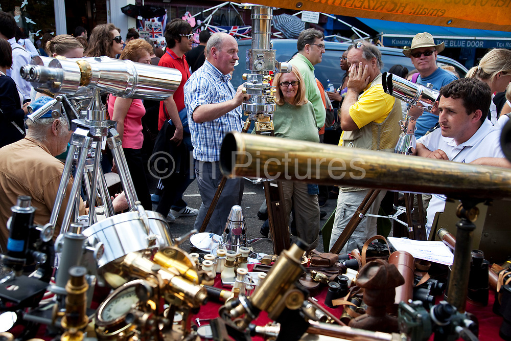 Optical instruments stall on Portobello Road market, Notting Hill, West London. This famous Sunday market is when the antique stalls come out as well as the food stalls.