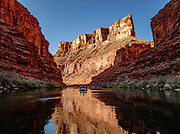"""Sunrise light spotlights a wall in Marble Canyon on day 2 of 16, where we breakfasted at Twentymile Camp at Colorado River Mile 20.2 in Grand Canyon National Park, Arizona, USA. Marble Canyon runs from Lees Ferry at River Mile 0 to the confluence with the Little Colorado River at Mile 62, which marks the beginning of the Grand Canyon. Although John Wesley Powell knew that no marble was found here when he named Marble Canyon, he thought the polished limestone looked like marble. In his words, """"The limestone of the canyon is often polished, and makes a beautiful marble. Sometimes the rocks are of many colors – white, gray, pink, and purple, with saffron tints."""""""