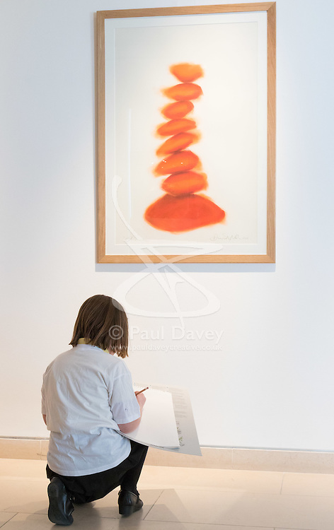 """Christies, St James, London, March 4th 2016. Nine year-old Ashley Hubbard from Charlton Manor Primary School does a drawing on David Nash's """"Column"""", created especially for the auction at the preview for the It's Our World charity auction at Christie's. Over 40 leading artists including David Hockney, Sir Antony Gormley, David Nash, Sir Peter Blake, Yinka Shonibare, Sir Quentin Blake, Emily Young and Maggi Hambling have committed artworks to the It's Our World Auction in support of The Big Draw and Jupiter Artland Foundation, to be sold at Christie's London on 10 March 2016.<br />  ///FOR LICENCING CONTACT: paul@pauldaveycreative.co.uk TEL:+44 (0) 7966 016 296 or +44 (0) 20 8969 6875. ©2015 Paul R Davey. All rights reserved."""