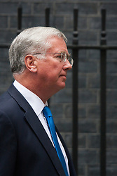 London, September 1st 2014.  Defence Secretary Michael Fallon leaves Downing Street after senior Tories met with Prime Minister David Cameron ahead of his addr4ess to Parliament on increased anti-terror measures. PAYMENT/CONTACT DETAILS: paul@pauldaveycreative.co.uk Te' +44 (0) 7966 016 296 or +44 (0) 208 969 6875