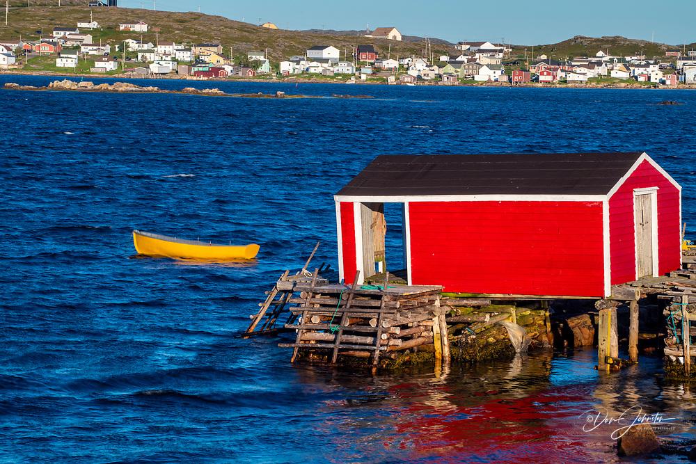 Red 'stage' building and yellow dory, Joe Batt's Arm, Newfoundland and Labrador NL, Canada