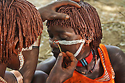 Africa, Ethiopia, Omo River Valley Hamer Tribe Applying body paint before the start of the Jumping of the Bulls ceremony