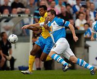 Photo: Richard Lane.<br />Bristol Rovers v Wycombe Wanderers. Coca Cola League 2. 08/08/2006. <br />Wycombe's Kevin Betsy breaks past Steve Elliott.