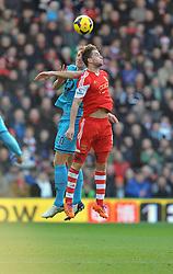 Tottenham Hotspur's Michael Dawson and Southampton's Jay Rodriguez battle for a high ball. - Photo mandatory by-line: Alex James/JMP - Tel: Mobile: 07966 386802 22/12/2013 - SPORT - FOOTBALL - St Mary's Stadium - Southampton - Southampton v Tottenham Hotspur - Barclays Premier League