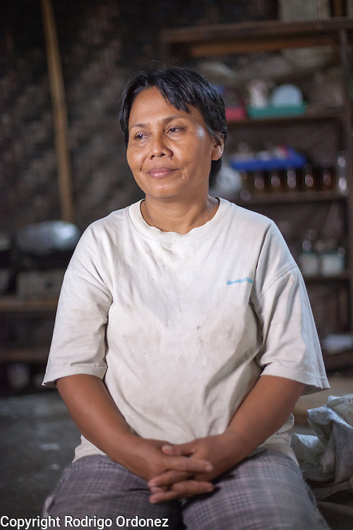 Suparjiyem, 49, poses for a photograph at her home in Wareng, Wonosari subdistrict, Gunung Kidul district, Yogyakarta Special Region, Indonesia.