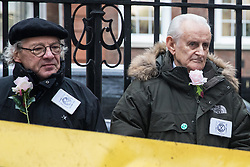 London, UK. 6 December, 2019. Marko Stepanov (l), 67, and Peter Cole (r), 76, climate change activists from Extinction Rebellion, stand outside the Conservative party headquarters on the 19th day of a Global Hunger Strike for Climate Justice intended to apply pressure on political parties to place the climate and ecological emergency at the centre of their general election campaigning.