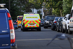 © Licensed to London News Pictures. 27/06/2019. London, UK. Police vehicles are seen near the Uxbridge Road in Shepherd's Bush where a teenager was fatally stabbed last night. Police were called at 9.20 PM on Wednesday, 26 June following reports of a stabbing. Officers found the male, believed to be aged 18 suffering from a stab injury but despite the efforts of paramedics the teenager died at the scene a short while later. Photo credit: Guilhem Baker/LNP
