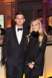 Jeremy Irvine and Jodie Spencer at The Sugarplum Dinner 2017 to benefit the type 1 diabetes charity JDRF held at the Victoria & Albert Museum, Cromwell Road, London England. 14 November 2017.