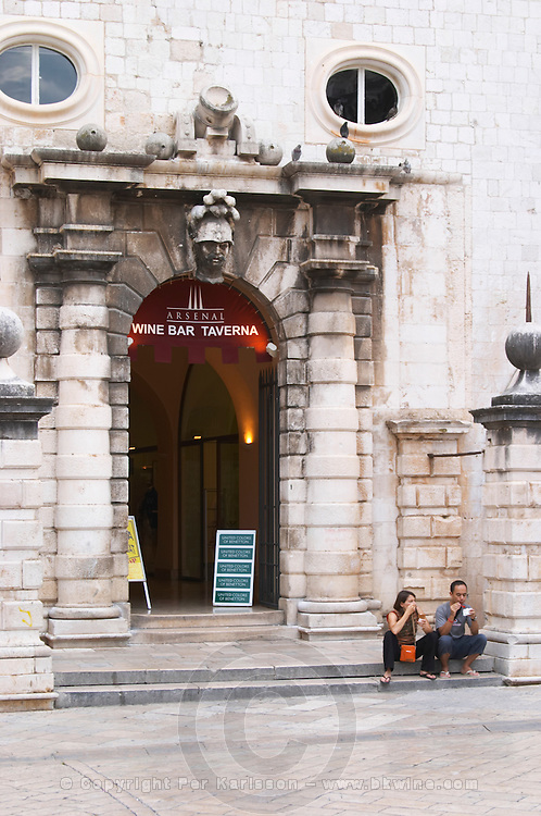 Entrance to the Arsenal tavern restaurant and wine bar in the bell tower on the Luza Lodge Loggia Square on the Luza Lodge Loggia Square Dubrovnik, old city. Dalmatian Coast, Croatia, Europe.