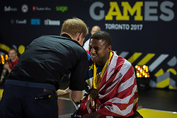 Prince Harry congratulates Ryan Major of the USA on his bronze medal in indoor rowing at the Invictus Games in Toronto, ON, Canada, on Toronto, ON, Canada, on Tuesday, Sept. 26, 2017. Photo by Chris Donovan/CP/ABACAPRESS.COM