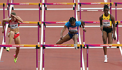USA's Christina Manning (centre) on her way to winning heat 2 of the Women's 100 Hurdles Semi Final during day eight of the 2017 IAAF World Championships at the London Stadium.