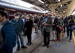 © Licensed to London News Pictures. 20/05/2021. London, UK. Passengers wait to board The world famous LNER Flying Scotsman steam locomotive as it prepares to leave Victoria Station in central London ahead of a tour through the Surrey Hills in South east England. The heritage steam locomotive touring season was mostly cancelled last year due to the Covid-19 pandemic but is now underway as restrictions are eased. Built in 1923 for the London and North Eastern Railway (LNER)It was the first steam locomotive to reach 100 miles per hour . Photo credit: Ben Cawthra/LNP