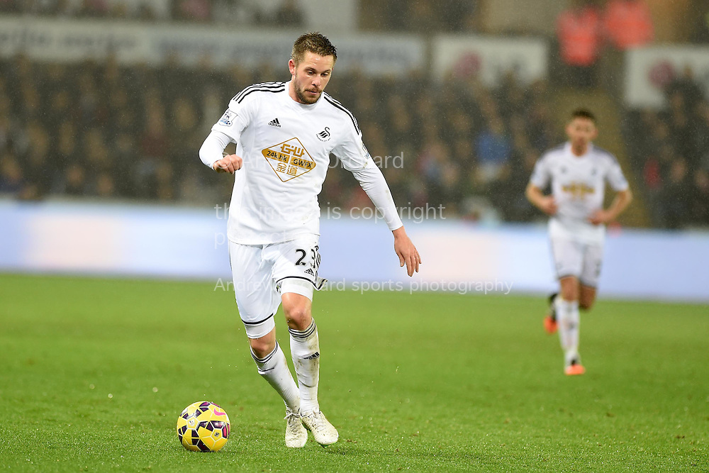 Gylfi Sigurdsson of Swansea city in action.Barclays Premier League match, Swansea city v Tottenham Hotspur at the Liberty Stadium in Swansea, South Wales on Sunday 14th December 2014<br /> pic by Andrew Orchard, Andrew Orchard sports photography.