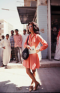 Connie Chung waits  for her crew to set up when Mrs. Nixon visits a gold market in Jeddah Saudi Arabia in June 1974..Photograph by Dennis Brack BBBs 20