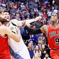 22 November 2016: Denver Nuggets center Jusuf Nurkic (23) vies for the rebound with Chicago Bulls center Robin Lopez (8) and Chicago Bulls guard Rajon Rondo (9) during the Denver Nuggets 110-107 victory over the Chicago Bulls, at the Pepsi Center, Denver, Colorado, USA.