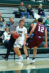 17 November 2017:  Brant Wolfe guarded by Ryan Stevens during an College men's division 3 CCIW basketball game between the Alma Scots and the Illinois Wesleyan Titans in Shirk Center, Bloomington IL