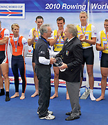 Bled, SLOVENIA,   left, GBROWING team Manager David TANNER, receives with the World Cup team Trophy from FISA President Denis OSWALD. at the 1st FISA World Cup. Rowing Course. Lake Bled.  Sunday  30/05/2010  [Mandatory Credit Peter Spurrier/ Intersport Images]