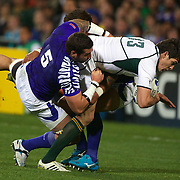 Jaque Fourie, South AFrica, is tackled by Kane Thompson, Samoa, during the South Africa V Samoa, Pool D match during the IRB Rugby World Cup tournament. North Harbour Stadium, Auckland, New Zealand, 30th September 2011. Photo Tim Clayton...