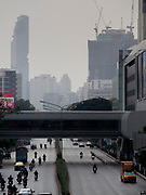 "14 JANUARY 2019 - BANGKOK, THAILAND:       Air pollution obscures the Bangkok skyline looking down Phaya Thai Road. Bangkok has been blanketed by heavily polluted air for almost a week. Monday morning, the AQI (Air Quality Index) for Bangkok  was 182, worse than New Delhi, Jakarta, or Beijing. The Saphan Kwai neighborhood of Bangkok recorded an AQI of 370 and the Lat Yao neighborhood recorded an AQI of 403. An AQI above 50 is considered unsafe. Public health officials have warned people to avoid ""unnecessary"" outdoor activities and wear breathing masks to filter out the dust.    PHOTO BY JACK KURTZ"